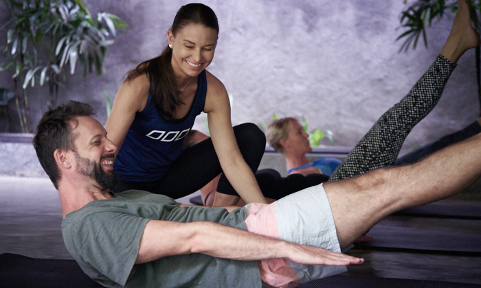 building core strength with Joseph Pilates' The 100 movement at Ubud Pilates Studio in Bali
